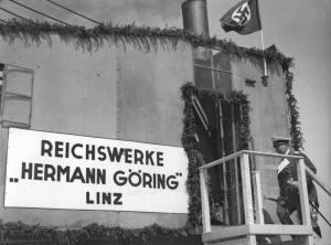 """Fundación de la sucursal de las Reichswerke """"Hermann Göring"""" en Linz (1938), cuya finalidad era la explotación del hierro doméstico."""